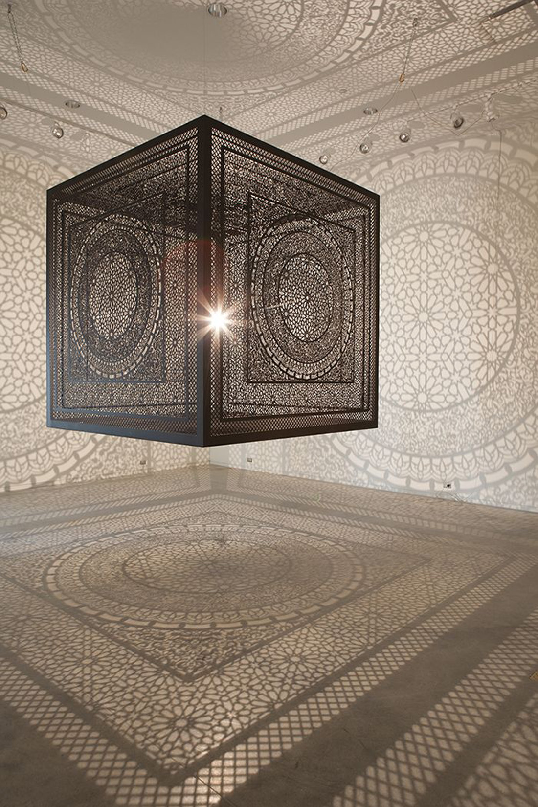 Floating cube installation projects massive shadow patterns by Anila Quayyum Agha